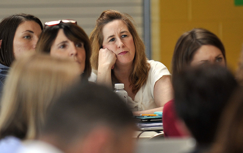 Cecilia Joyce, a third-grade teacher at the East End Community School, listens along with other teachers as Principal Marcia Gendron addresses staff about the F grade the school received on Wednesday, after the LePage administration released its new education grading system.