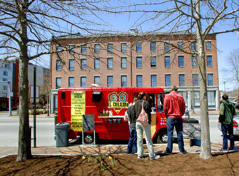 Customers queue up at El Corazon food truck, which was parked on Commercial Street in Portland on Sunday.