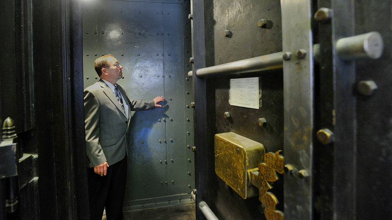 Tom Severance, property manager at the Custom House, stands inside one of the large vaults in the historic building. Long ago in the building's Customs Hall, merchants paid taxes on imports and exports under the watchful eye of armed guards.