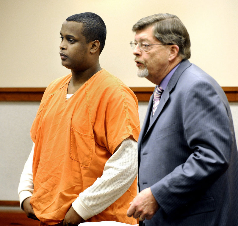 In this March 12, 2013 file photo, Mohammed Abdi with his attorney Clifford Strike. Prosecutors in the case against two Portland men accused of gang raping a woman at gunpoint last summer have been unable to find the woman since she moved out of state and have offered plea agreements to both men.