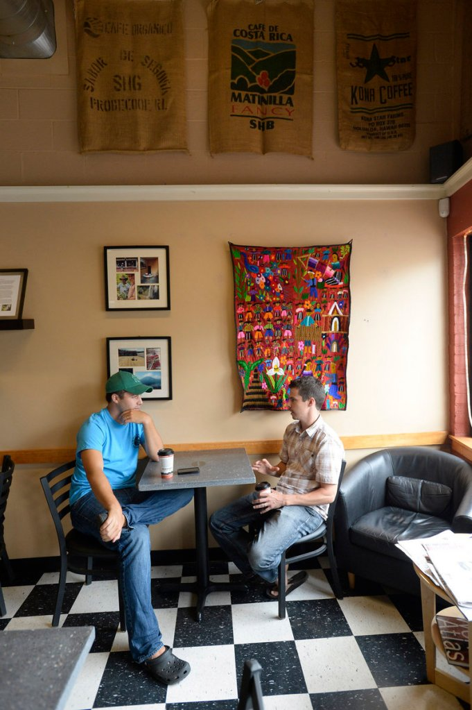 Patrons Brian King of Gorham and Clark Carter of Portland converse last week at Coffee By Design's Washington Avenue location in Portland.