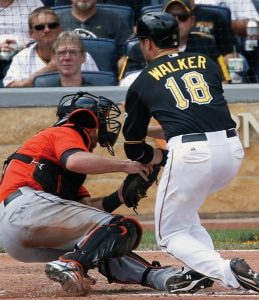PITTSBURGH'S Neil Walker (18) is out at home as he collides with Miami Marlins catcher Jeff Mathis while trying to score from second on a single by Pedro Alvarez in the fifth inning of a baseball game on Thursday in Pittsburgh. The Pirates won 5-4 in 10 innings.