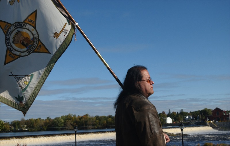 """In this 2006 file photo, then-Penobscot Tribal Council member James Neptune watches an eagle fly over the Penobscot River in Orono, Maine. The federal government, saying """"intervention is not a step the United States takes lightly,"""" has asked a court to allow it to join the Penobscot Indian Nation in its lawsuit against the state over fishing and hunting rights on its ancestral river. (AP Photo/Bangor Daily News, Kevin Bennett)"""