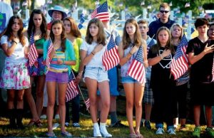 FREEPORT MIDDLE SCHOOL STUDENTS listen to the Star Spangled Banner at a ceremony Wednesday morning marking the anniversary of Sept. 11, 2001 in Freeport. They're too young to remember the original event and some are currently studying it in school. STORY, A3.