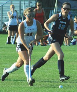 LISBON HIGH SCHOOL field hockey player Mariah Breton (11) carries play during Wednesday's home action versus Dirigo.The Greyhounds prevailed, 4-1.