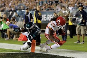 KANSAS CITY CHIEFS' Jamaal Charles, right, is blocked from the end zone by Philadelphia Eagles' Patrick Chung during the second half of an NFL football game on Thursday in Philadelphia.