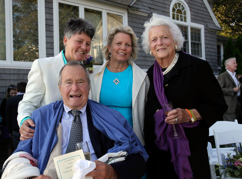 Former President George H.W. Bush and former first lady Barbara Bush, right, pose for photos after the wedding of longtime friends Helen Thorgalsen, center, and Bonnie Clement, in Kennebunkport on Saturday.