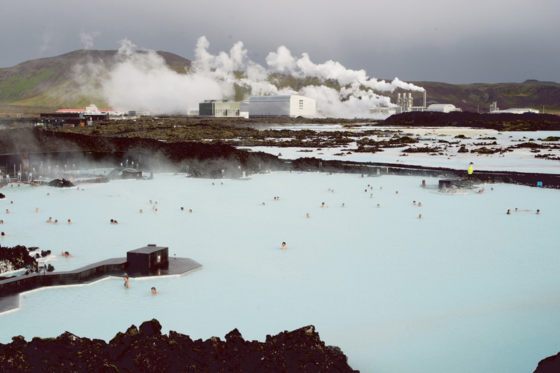 Tourists bathe in the Blue Lagoon, a geothermal spa and one of Iceland's most popular attractions. The man-made lagoon is fed by the output from a nearby geothermal power plant. Superheated water is vented from nearly a mile below the surface and used to run turbines that generate electricity.