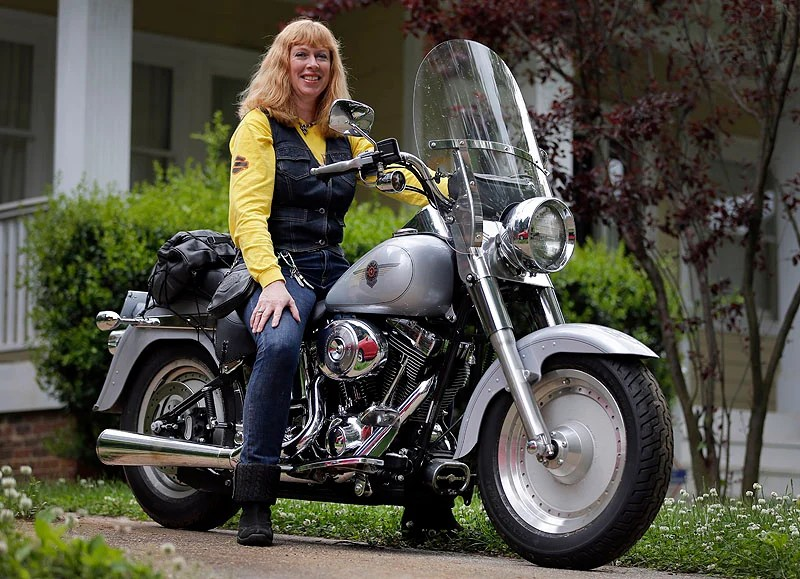 Crystal Swift poses on her Fat Boy Harley-Davidson in Charlotte, N.C. Harley is the top seller of motorcycles in its class in the U.S. and leads among women, minorities and younger adults.