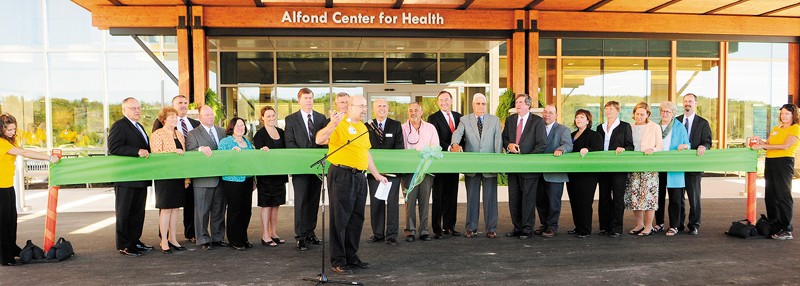 The Rev. David Gant, director of spiritual care, center, says a prayer before a ceremonial ribbon cutting of the MaineGeneral Medical Center's new Alfond Center for Health on Saturday. The Augusta hospital opened its doors to a crowd of about 1,500 well-wishers.