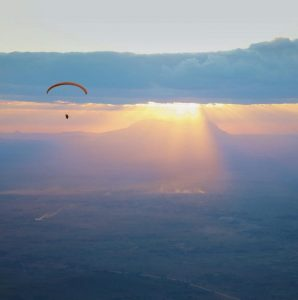 GODFREY MASAULI flies down the slope of Sapitwa Peak, making him the first paraglider pilot in Malawi.