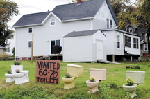 David Labbe is looking for 60 to 70 toilets, in addition to the five already there, to install on his lawn in Augusta to protest the city's decision to deny a zoning change that would have permitted Dunkin' Donuts to build a store on the property.