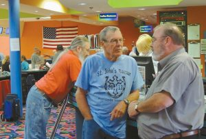 NELSON MOODY, right, talks with a patron at Yankee Lanes on Bath Road in Brunswick. On Oct. 4, Moody purchased the 32-lane 10-pin institution from its original owner, Colchester, Vt.-based Bowl New England.