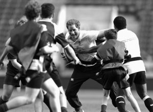 BRITAIN'S PRINCE HARRY, patron of the Rugby Football Union, center, plays rugby as he takes part in a coaching session at Twickenham Stadium in London, Thursday, for young people from participating secondary schools across the country.