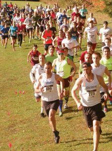 THE SIXTH ANNUAL Betty ReeZ WhoopieZ 5K and One-Mile XC Trail Run was held Monday at Pownal Road Field in Freeport. In the above photo, overall winner Joshua Zolla of Freeport (775) leads the runners up the first hill, while on the right is first female Elly Bengtsson and second-place finisher Andy Spaulding. The event was hosted by the Freeport Running Boosters with proceeds to support running in the greater Freeport communities. See race results on B3.