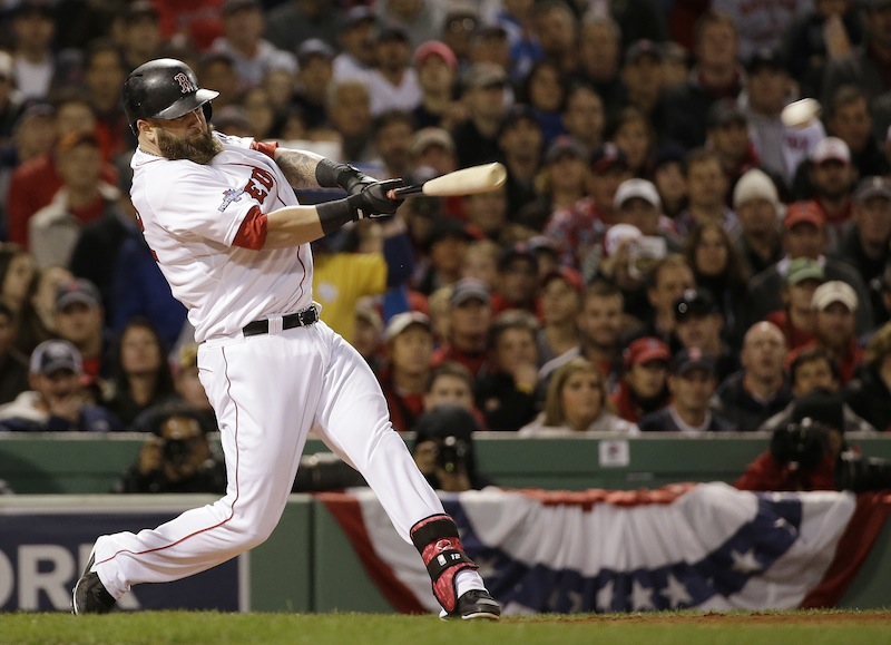 Boston Red Sox's Mike Napoli hits a three-run scoring double during the first inning of Game 1 of baseball's World Series against the St. Louis Cardinals Wednesday, Oct. 23, 2013, in Boston. MLB