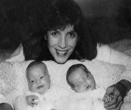 Karen Wood, pictured with her twin daughters, died after being shot by a deer hunter while she was in her back yard in Hermon 20 years ago.
