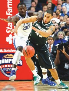 MICHIGAN STATE guard Denzel Valentine (45) steals the ball from Kentucky forward Julius Randle during the second half of an NCAA college basketball game on Tuesday in Chicago. Michigan State won 78-74.