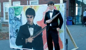 PADEN STANTON stands next to a mural of the character he plays in the Mohiba variety show.