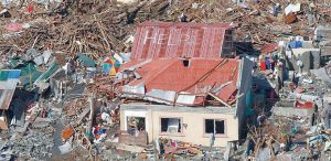 An aerial view shows signs for help and food amid the destruction left from Typhoon Haiyan in the coastal town of Tanawan, in the central Philippines, today. Typhoon Haiyan, one of the strongest storms on record, slammed into six central Philippine islands on Friday leaving a wide swath of destruction and thousands of people dead. See story on page A6.