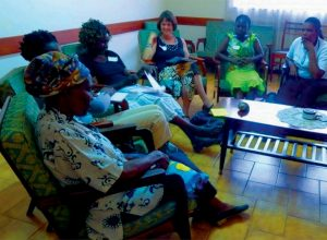 BRUNSWICK PSYCHIATRIST Lynn Ouellette meets with Kenyan woman at a support group in Nyumbani village.