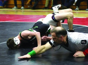 """MORSE HIGH SCHOOL wrestler Corey Lent (left) works on his spin moves, while teammate Chad Bonti goes through his mat skills routine during Monday's practice at """"The Pit.' Yesterday was the first official practice day for basketball, wrestling, indoor track, swimming and boys ice hockey."""
