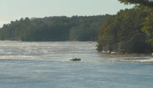 THE MAINE MARINE PATROL notified the owner of this 24-foot sloop it was adrift in the Kennebec River. The boat had fetched up on the Phippsburg shore on Fiddler's Reach, just below Bath, and was stuck in the ice.