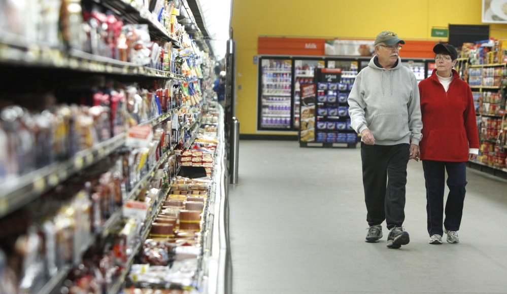 Skip and Thea Murphy of Sanford walk around the inside perimeter of the 198,000-square-foot Walmart in Sanford.