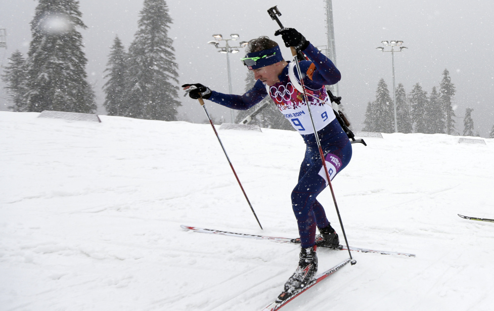 Norway's Emil Hegle Svendsen competes to win the gold medal in the men's biathlon 15k mass-start, at the 2014 Winter Olympics, Tuesday, Feb. 18, 2014, in Krasnaya Polyana, Russia.