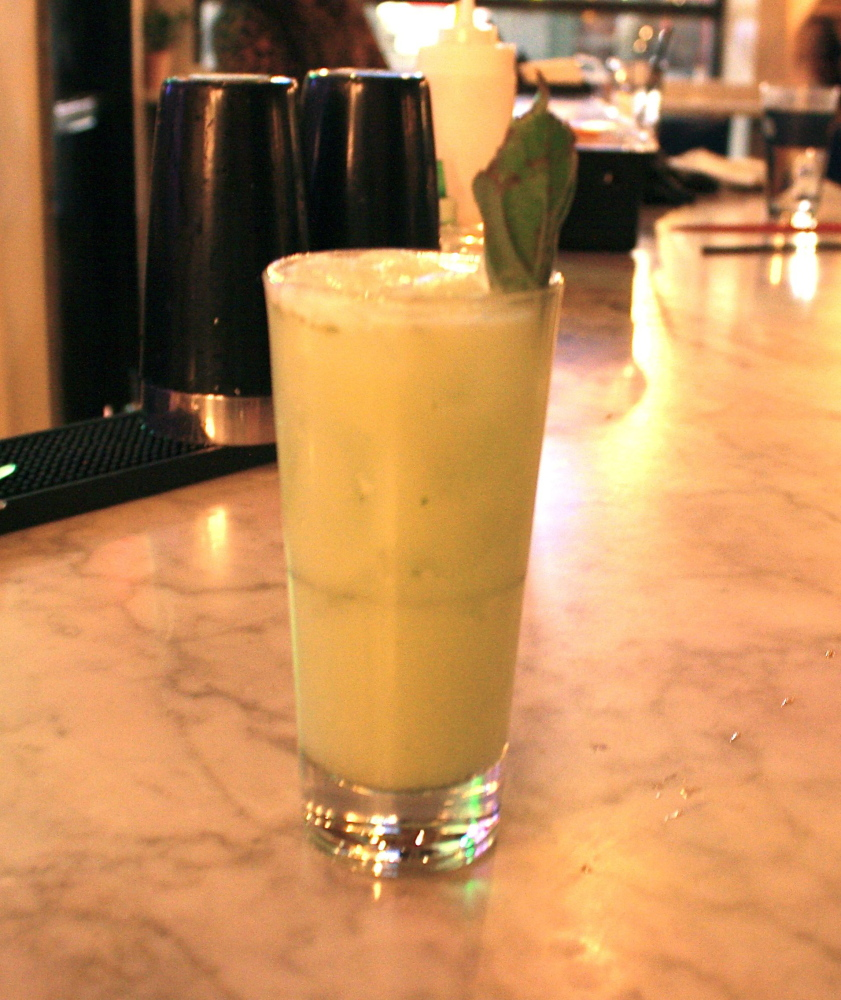 A popular drink at Empire, Dragon's Milk is a mix of coconut milk, green tea-infused gin, pandan syrup and Thai basil leaves.