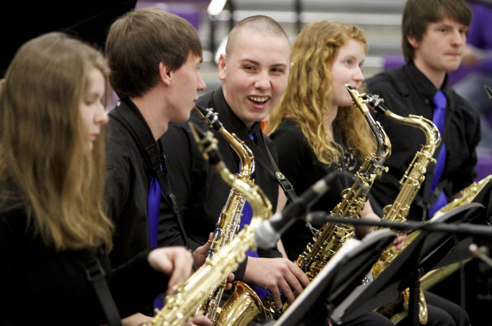 Westbrook Blue Blazes alto sax player Gary Sanville smiles at fellow band member Jacob Violette during the Maine State High School Instrumental Jazz Festival in Hampden on Saturday. Members of the Blue Blazes jazz band got a standing ovation for their performance.