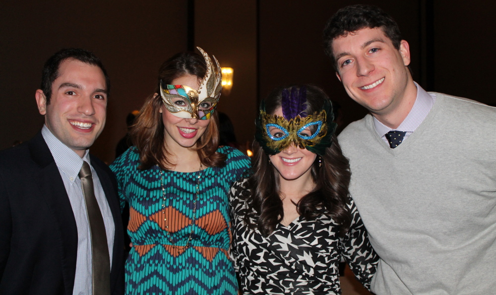 Brandon Rubenstein, left, of CogSports, Aly Myles of WMTW-8, Virginia Templet of Puritan Medical Products and Jeffrey Lewis of Key Bank at the recent Freeze Out Hunger gala at the Westin Portland Harborview Hotel.