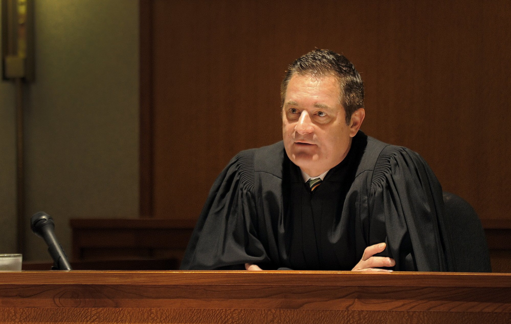 Judge Jeffrey Moskowitz addresses a client during a drug court session in Cumberland County Superior Court in 2013.