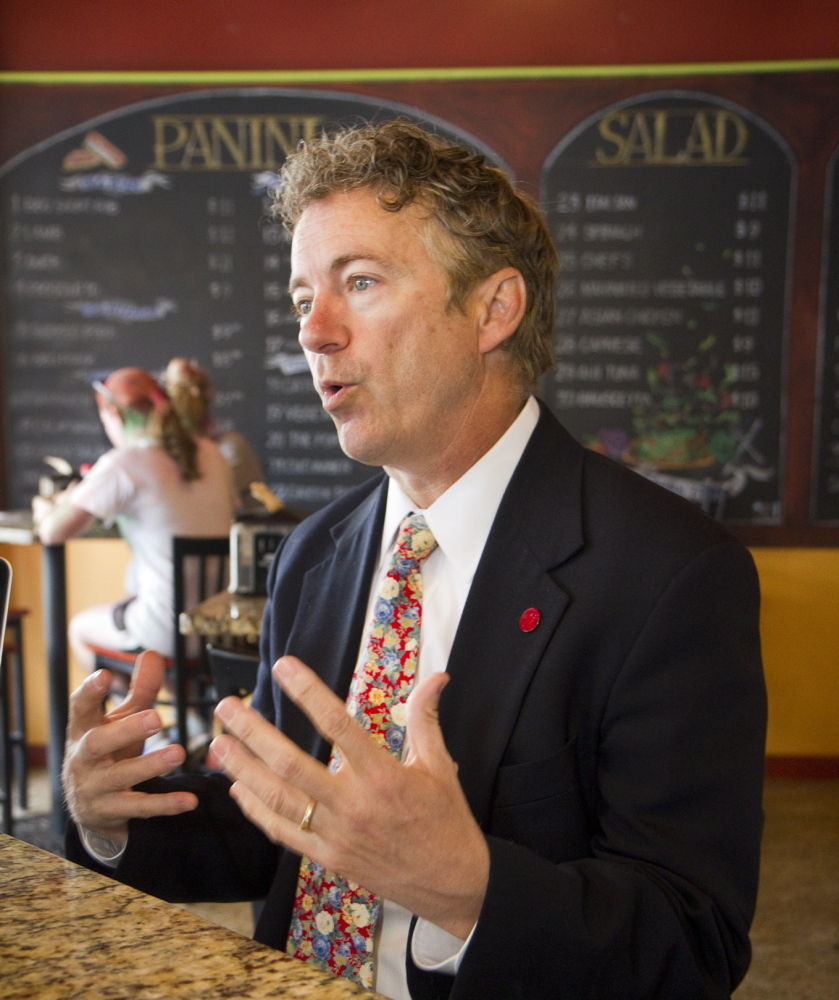 Sen. Rand Paul of Kentucky answers questions during an interview at Giacomo's coffee shop in Bangor on Saturday.