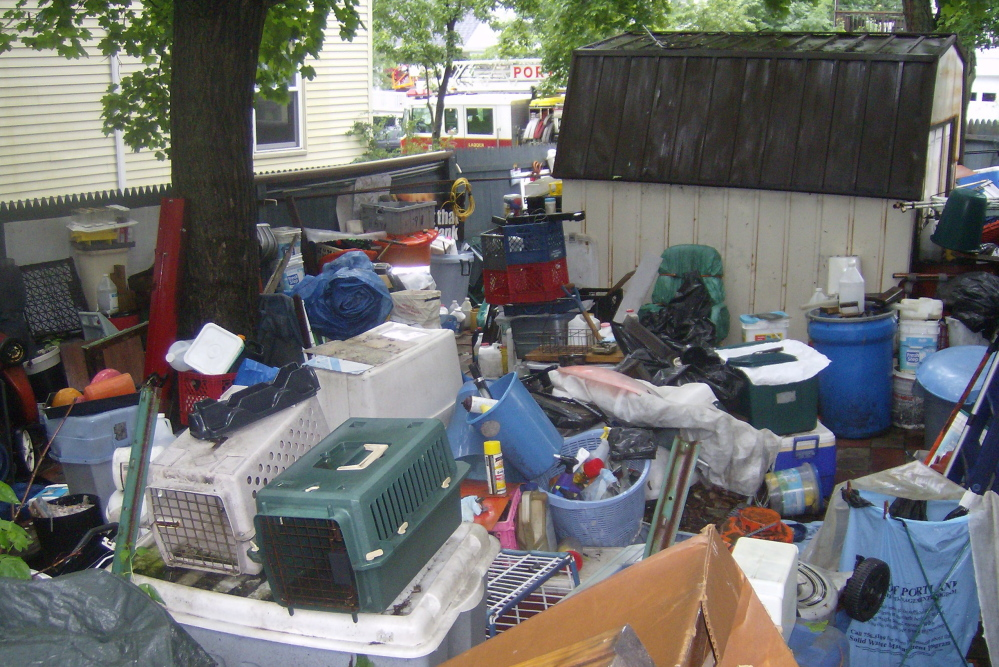 Although most hoarders keep their accumulation of stuff inside the home where it won't embarrass them, sometimes the mess spills outside, like it did at this Portland residence in 2009.