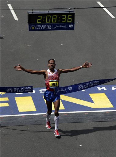 Meb Keflezighi of San Diego, Calif., breaks the tape to win the 118th Boston Marathon.