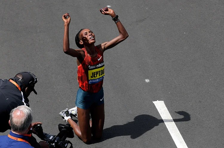 Rita Jeptoo of Kenya celebrates her win in the women's division.