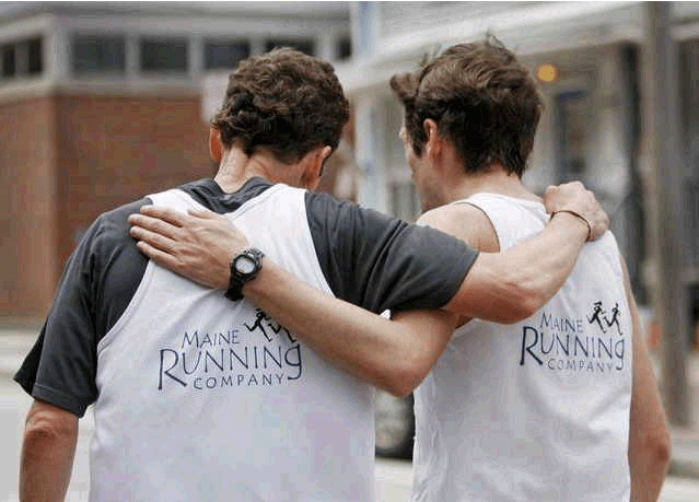 Mike Payson of Falmouth, left, who finished third, and Chris Harmon, who finished first, share a moment after the race.