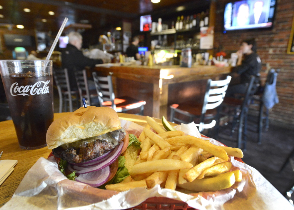 A classic cheeseburger with fries at Rosie's Restaurant and Pub in Portland.