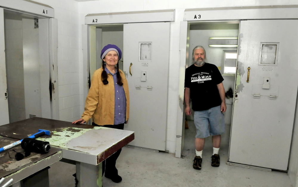 Annie Stillwater Gray and Timothy Smith visit the former Somerset County Jail's cellblock E13 on Thursday. With donated rent, CDs and a computer and with funds that they are still raising, they plan to turn the prison space into a community-centered, noncommercial radio studio.