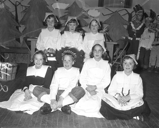 From the Thursday, Nov. 22, 1956 Portland Press Herald, page 27. Original caption: 'Several members of the cast of the Thanksgiving play given yesterday in Butler School are, seated, left to right, Kay Holt, John Huack, Matha Moulton and Patricia Strout. Standing, left to right, Sally Heflin, Joanne McDonough and Deborah Pierce.'