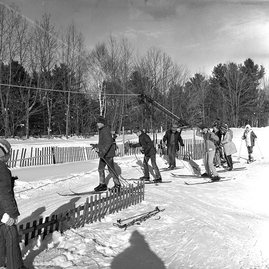 Skiers line up to ride up the rope tow at the Gorham Community Ski Tow in this photo from the Dec. 31, 1970 Portland Evening Express. Courtesy of Portland Public Library Special Collections & Archives.