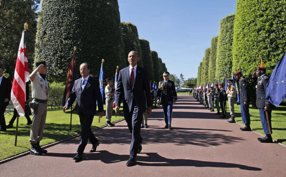 The Associated Press President Obama and French President Francois Hollande arrive at Normandy American Cemetery at Omaha Beach to participates in the 70th anniversary of D-Day, in Colleville sur Mer in Normandy, France, Friday.