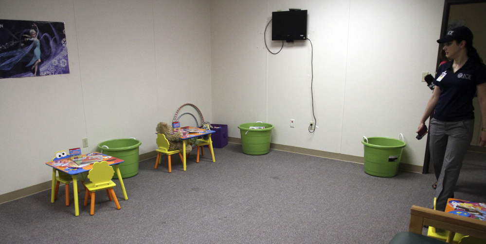 U.S. Immigration press secretary Barbara Gonzales enters a playroom at a detention center in Artesia, N.M., on Thursday. The U.S. has apprehended more than 52,000 children since October.