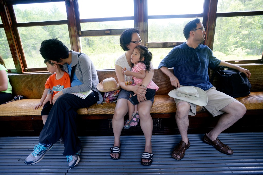 Left to right: Elliot Choi 4, Jane Sunoo, Saura Choi, Lydia Choi, 2, and Isaac Choi of New Jersey, enjoy a ride on a trolley at the Seashore Trolley Museum in Kennebunkport Wednesday, June 18, 2014.