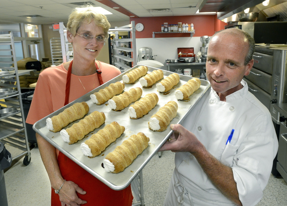 Molly and Ed Foley – and a tray of creme horns. Though they sold the business, the bakery will continue with the Foley name and assurances that the new owner will keep things as is.