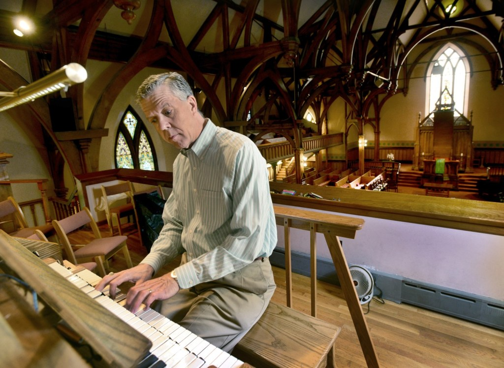 Ray Cornils, Portland's municipal organist, is also the minister of music at First Parish Church in Brunswick, where's he's seen playing in 2014.