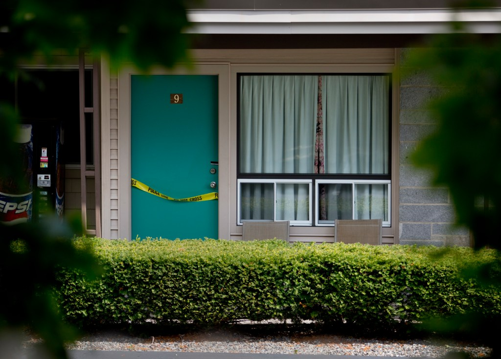 Crime scene tape was draped over the door of Room 9 of the Sleepy Hollow Motel in Biddeford Wednesday. Gabe Souza / Staff Photographer