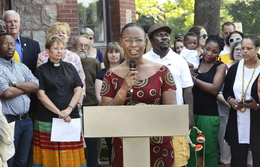 Suavis Furaha, an asylum seeker from Burundi, speaks during a June 28 news conference at Deering Oaks in Portland to protest Gov. LePage's cuts to General Assistance to undocumented immigrants.