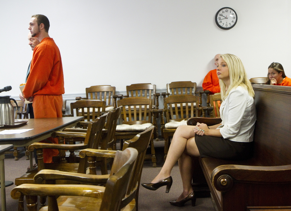 Former Southern Maine RE-entry Center guard Bret Butterfield stands before the judge at his bail hearing as his wife Emily Butterfield looks on at right, at York County Superior Court in Alfred on Friday.